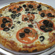 "Price range from $11.50 to $16.50 for 10"", 12"" and 16"" - Greek Pizza at Toula's House of Pizza"