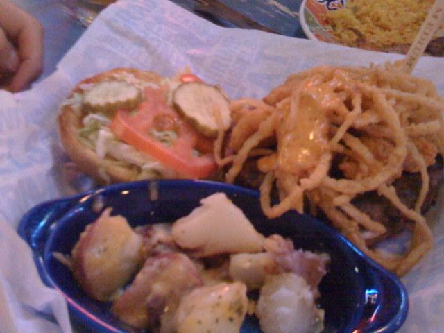 Fried shrimp on a burger - JOE'S SURF N TURF BURGER at Joe's Crab Shack