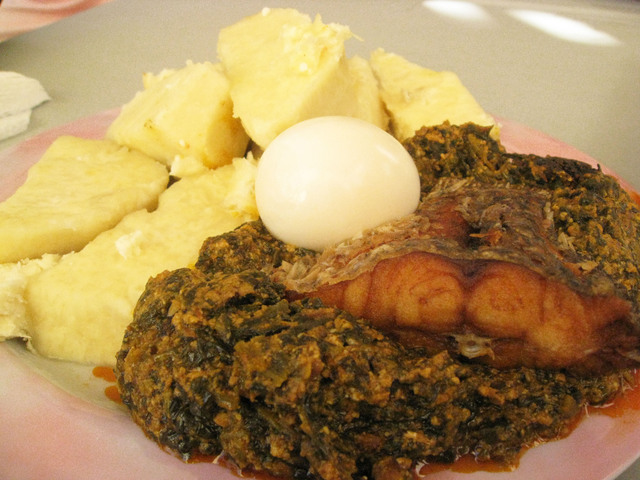 Photo of Deep Fried Tilapia on a Bed of Spinach served with Yam and Egg
