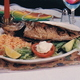 Deep fried ocean perch fish sauteed with garlic and butter - mojarrita al mojo de ajo at Costa Azul Restaurant