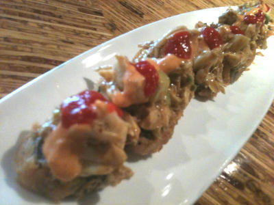 Sliced tempura fried sushi roll, topped w/ jumbo lump crab, harissa mayo, avocado, ginger, cucumber - Jimmy Roll at Talara