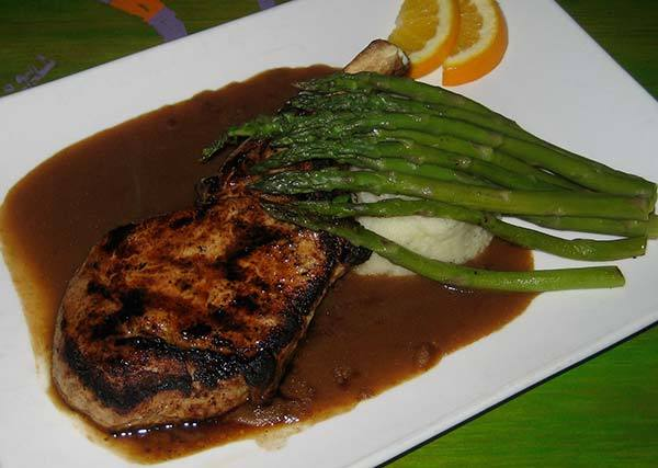 Bone-in Pork Chop in LIsta's Sangria Gravy at Lista's Grill
