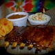 The best rub in town. Selection of great sauces on every table. - St. Louis Style Ribs at CJ's Bar B Skew