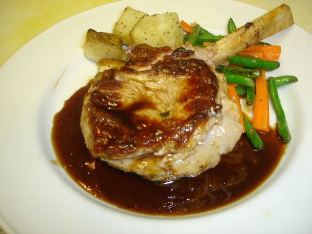 Veal Chop milk-fed Frenched and pan seared served with Port wine demi glace at Bistro Albertino