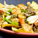 Tortilla chips topped with cheese, grilled steak or chicken, onions, bell peppers, tomatoes  - Fajitas Nachos at Jalapeno's