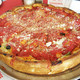 Half with pepperoni/sausage and half olives/bell peppers and onions. at Tony's Little Italy Pizza