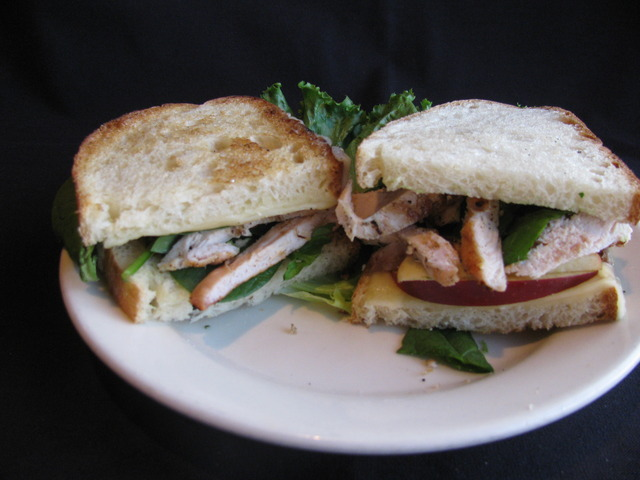 Our perfectly seasoned flame-grilled chicken with slices of crisp apples, spinach leaves and melted  - Orchard Chicken Panini at Chicago Blu Grill and Bar