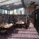 Glass-Enclosed Patio Area With Natural Light - Interior at Tam O'Shanter Inn