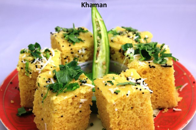 A moist and spicy lentil cake served with green and sweet chutneys  - Khaman at Standard Sweets and Snacks