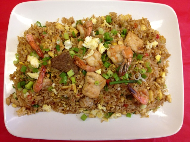 Peruvian Fried Rice mixed with chicken, beef & shrimp - Chaufa Especial at Polleria El Gordo