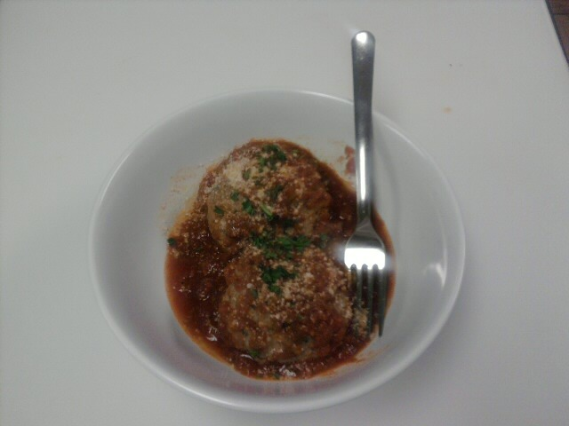 Succulent meatballs in our homemade tomato sauce which around here we call gravy. - Meatballs and Gravy at Pie-zans Pizza