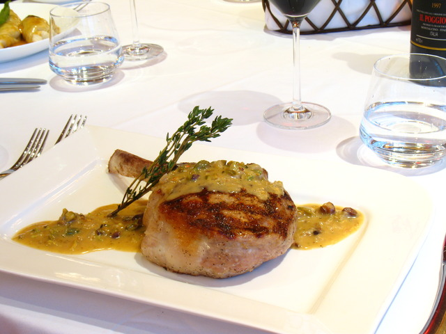 Vetro's Signature Flame Grilled Veal Chop with Pistachio Sauce - Dish at Vetro by Russo's on the Bay