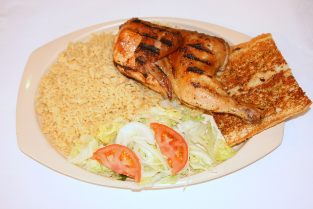Rice Pilaf, Salad with Greek Dressing, and Garlic Bread - Greek Chicken at Squabs Gyros