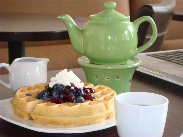We can't make this fast enough! - Hot Buttery Belgian Waffles at Teavolve Cafe & Lounge
