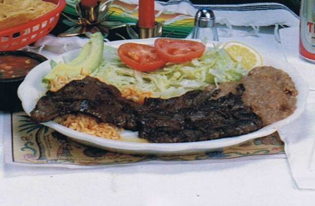 broiled skirt steak serve with beans and rice  - carne asada at Costa Azul Restaurant