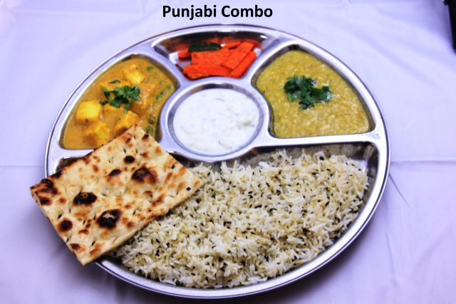 Jira rice, dal tadka, 1 vegetable curry, fresh tandoori naan, pickle, raita, and a soda or tea  - Punjabi Combo at Standard Sweets and Snacks