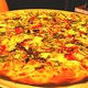It's a big, tasty pizza - Drag it through the garden at Joey Nova's
