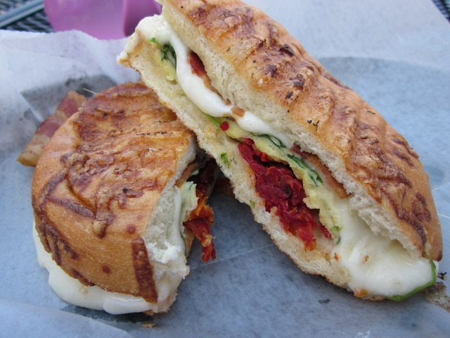 Two eggs, bacon, spinach, mozzarella and sun-dried tomatoes... I opted for an asiago bagel. - Bacon Panini at Bittersweet