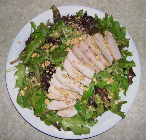 Organic greens tossed in spicy peanut dressing with grilled chicken breast - The Galactic at Atomic Cafe