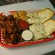 Breaded Mozzarella Cheese Sticks, Breaded Mushrooms, Vino's Bread, Pizza Rolls and Breaded Pickles - Vino's Sampler at Vino's