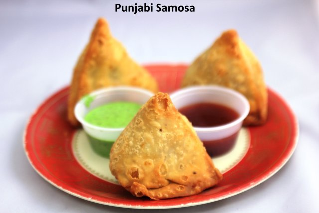 A traditional pastry filled with potatoes and green peas.  - Punjabi Samosas at Standard Sweets and Snacks