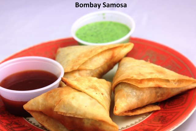 A triangle pastry stuffed with mix vegetables. - Bombay Samosas at Standard Sweets and Snacks