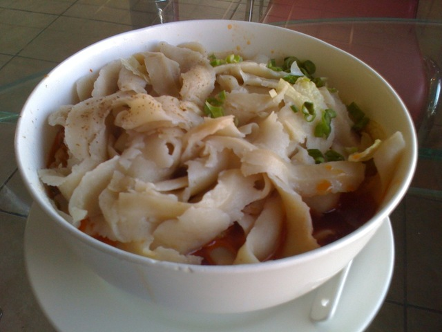 Photo of Dan Dan Noodles with hand shaved noodles