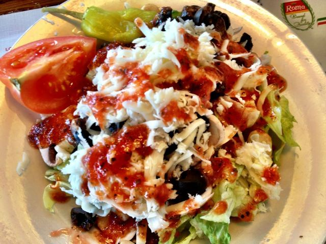 Fresh sliced mushrooms, black olives, mozzarella cheese, tomato and pepperoncini peppers served over - AMICI'S HOUSE SALAD at Amicis Family Restaurant