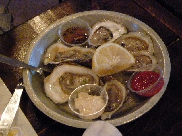 Malpeque oyster plate, served with lemon, hot sauce, and mayonnaise - oysters on ice at Oyster Shack