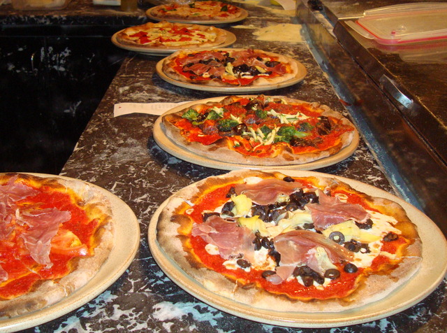 Thin Crust Oven Brick Pizza with Gourmet toppings. - Brick Oven Pizzas at Caffe Capri