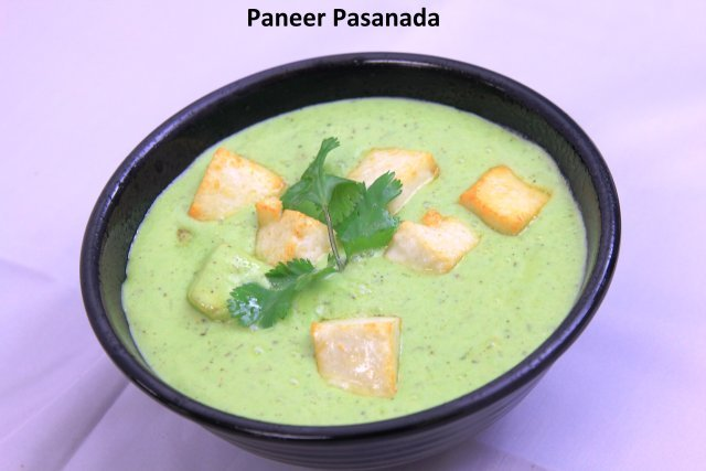 An original dish with paneer in a cilantro cashew gravy served with fresh tandoori naan  - Paneer Pasanda and Naan at Standard Sweets and Snacks