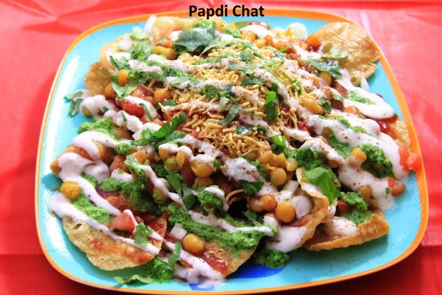 Handmade papdi with ragda, potatoes, moong, channa, sweet chutney, green chutney, yogurt, sev.  - Papdi Chat at Standard Sweets and Snacks