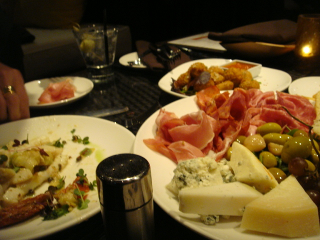 A generous platter with thinly sliced meats and great tasting cheeses - Charcuterie Platter at Tanzy