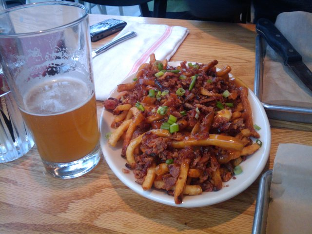 Objects in photo are less delicious than they appear. - Royal Mounted Bacon Poutine at Burger Jones
