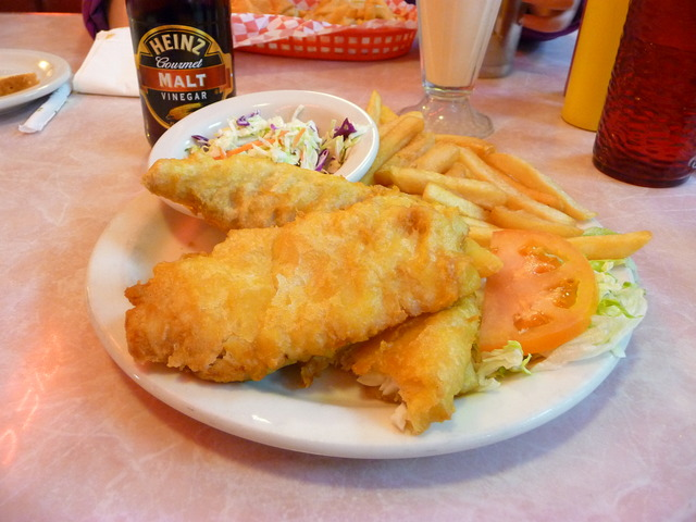 Nice size serving, good slaw and plenty of fries - Fish 'n Chips at Flashbacks Fountain and Grill