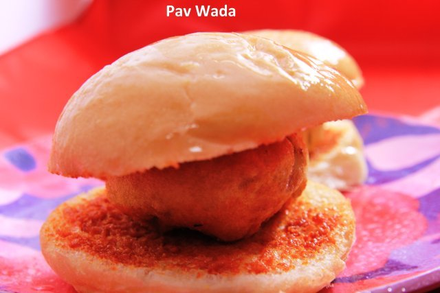 A mash potato fritter in a bun with spicy garlic chutney  - Pav Vada at Standard Sweets and Snacks