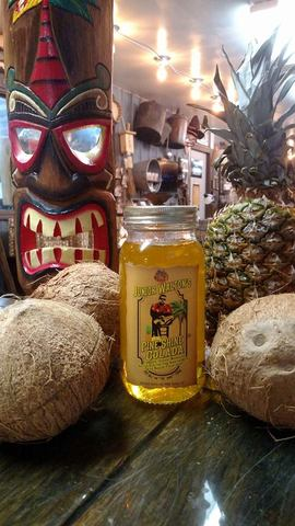 Limited sales on site. - Junior Walton's Pine Shine Colada at Walton's Distillery