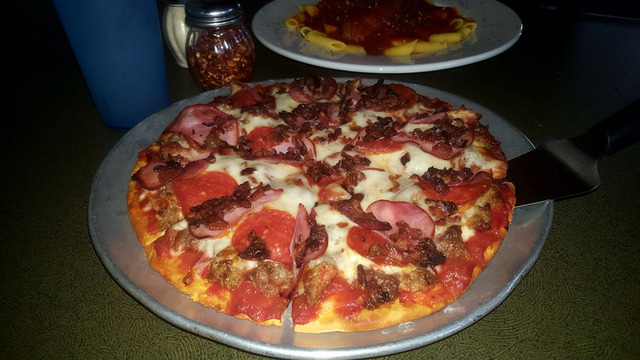 Gluten Free Pizza with meat pizza toppins at Vince's Restaurant & Pizzeria