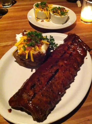 Delectable Fall-off-the-Bone BBQ Ribs and Overstuffed Baked Potato - Barbeque Ribs with Stuffed Baked Potato at Houston's