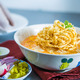 """KHAO SOI """"Northern Thai Curry Noodles""""     Egg noodle with red onion in yellow curry and toping wi - KHAO SOI """"Northern Thai Curry Noodles"""" at Top Thai Cuisine"""