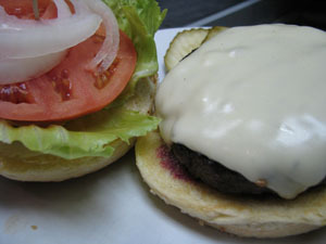 Cheeseburger at Shopper's Cafe Bar & Grille