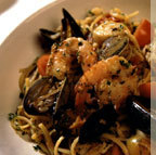 Sauteed with shrimp, scallops, manila clams, mussels, and calamari in a spicy marinara sauce - Frutti del Mare at Francesca's Tavola