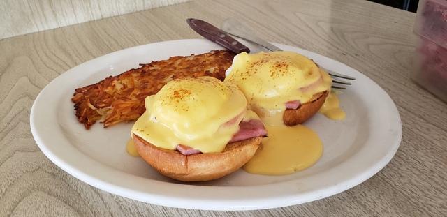 Fluffy and Firm Brioche Bun with Ham, Eggs Poached and a slice of Tomato - Brioche Benedict at Bobbi's Coffee Shop